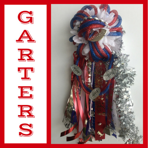 The Red White and Blue Homecoming Garter from Enchanted Florist includes a single garter flower, trinkets, metallic chain, and garter band in the school colors of your choice. This color is perfect for:  First Baptist Christian Academy Clear Lake High School Dawson High School  HMC142