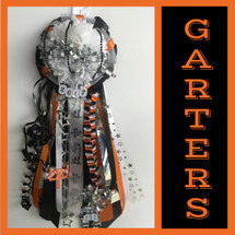 The Dobie High School Homecoming Garter from Enchanted Florist includes a single garter flower, trinkets, metallic chain, the Diamond Box braid and garter band in the school colors of your choice.  HMC143
