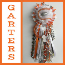 The La Porte High School Homecoming Garter from Enchanted Florist includes a single garter flower, trinkets, metallic chain, the Diamond braid and garter band in the school colors of your choice.  HMC144