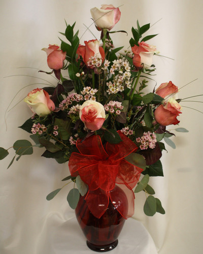 Cupid's Love Premium Dozen Roses by Enchanted Florist Pasadena TX. A premium Rio Ecuadorian rose, this beautiful white flower is hand dyed in red and pink giving it a truly unique look. A perfect choice for your unique Valentine's. RM960