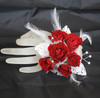 Premium Iridescent Contemporary Prom Corsage by Enchanted Florist Pasadena TX. This premium prom corsage is on a basic pearl bracelet with white lace leaves, pearl bling, diamond bling and feathers with red roses. PROM113