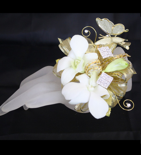 Premium Gold Contemporary Prom Corsage by Enchanted Florist Pasadena TX. This premium prom corsage is on a gold bling bracelet with gold leaves, rhinestone bling, gold swirls and a gold butterfly. Pictured with white orchids. PROM115