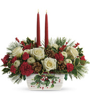 Halls Of Holly Centerpiece White roses, miniature red carnations, and white button spray chrysanthemums are accented with flat cedar, variegated holly, and white pine. Delivered in a Halls Of Holly dish.   T18X100B.