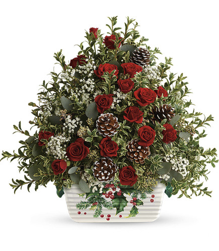 Warmest Winter Tree by Teleflora This heartwarming arrangement includes red spray roses, million star gysophila, oregonia, and seeded eucalyptus. Delivered in a Halls Of Holly dish.  T18X110B.