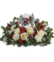 Thomas Kinkade's Christmas Bridge Bouquet  White roses, white carnations, and miniature red carnations are arranged with white sinuata statice, silver dollar eucalyptus, flat cedar, variegated holly, and noble fir. Delivered with a Thomas Kinkade's Snowfall Dreams keepsake.  T18X200B.