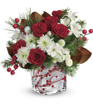 Wondrous Winterberry Bouquet  White alstroemeria, red carnations, white button spray chrysanthemums are accented with magnolia leaves, white pine, and douglas fir. Delivered in a Winterberry Kisses cube.  T18X600B.