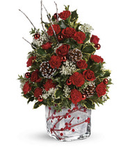 Festive Berries And Holly Tree This festive tree arrangement features red miniature carnations, million stay gysophila, oregonia, and variegated holly. Delivered in a Winterberry Kisses cube. T18X610B