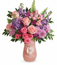 "Light pink roses, lavender spray roses, pink alstroemeria, lavender stock, lavender cushion spray chrysanthemums, and raspberry sinuata statice are accented with sword fern, huckleberry, and lemon leaf. Delivered in a Winged Beauty vase. Approximately 15 1/2"" W x 19 1/2"" H  18M100 RM820"