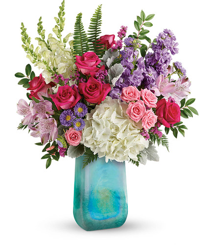 "White hydrangea, hot pink roses, pink spray roses, light pink alstroemeria, white snapdragons, lavender stock, lavender matsumoto asters and raspberry sinuata statice are arranged with dusty miller, leatherleaf fern, sword fern, and huckleberry. Delivered in an Art Glass Treasure vase. Approximately 18 1/2"" W x 22 1/2"" H  19M505"