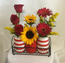 Lovely Red Trio Vase Bouquet by Enchanted Florist Pasadena TX. A beautiful trio of vases delivered to her door. This stunning collection includes red roses, sunflowers, and red gerbera daisies. RM813
