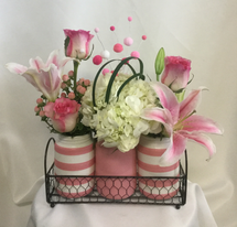 Poppy Pink Trio Vase of Flowers by Enchanted Florist Pasadena TX. A unique gathering of pink and white flowers in a trio of vases. It includes stargazer lilies, pink roses, white hydrangea and fun accents of lily grass and festive picks.  RM814