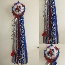 The Clear Lake High School Homecoming Mum from Enchanted Florist can be designed in any color for any school. It includes a single mum flower, trinkets, a chain, and a braid as shown. Two names are also included in the price. HCM155