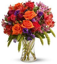 "Gemma Fall Orange Rose Bouquet by Enchanted Florist. Includes orange roses, burgundy gerberas, orange or red Asiatic lilies, alstroemeria, hypericum, purple lisianthus and millet are delivered in a clear glass gathering vase. Approximately 15"" (W) x 17"" (H)  SKU RM213"