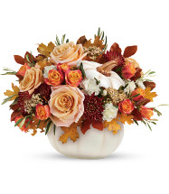 Harvest Charm Pumpkin Bouquet of Fall Flowers by Enchanted Florist. An elegant bouquet of crème roses blended with the heartwarming hues of autumn in this charming bouquet, artfully arranged in a white lidded pumpkin bowl, a versatile fall decor favorite!  SKU204