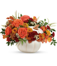 Enchanted Harvest Bouquet by Enchanted Florist is bursting from an enchanting white ceramic pumpkin, with a fabulous fall mix of roses and mums is a magical addition to your autumn gatherings with friends or family. Makes a great gift for the friendly season. ITEM T19H200