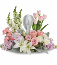 Pink Garden of Hope Flowers with Angel Statue from Enchanted Florist. This lovely arrangement includes light pink roses, light pink tulips, white oriental lilies, light pink carnations, white snapdragons, white carnations, and light pink stock is accented with white filler flowers and assorted greenery. Flowers are delivered with Angel statue. Pearland funeral flowers. SKU RM558