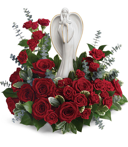 Forever Ours Funeral Angel Flowers in Red from Enchanted Florist Pasadena TX. This peaceful white porcelain angel sculpture is surrounded by radiant red roses and mini spray roses with delicate greenery, is a touching tribute to a rich life. Hand delivered with the angel statue. RM560