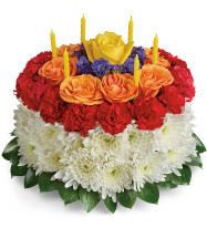Make a Wish Birthday Cake Flower Bouquet from Enchanted Florist. This festive cake arrangement is made up of yellow roses, orange spray roses, red miniature carnations, white cushion spray chrysanthemums, blue statice, and accented with greenery. Hand delivered on a cake tray and stand. SKU RM173