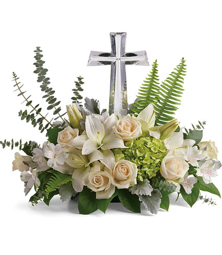 Life's Glory Large Crystal Cross from Enchanted Florist. These beautiful funeral flowers include green hydrangea, white roses, white oriental lilies, and white alstroemeria are accented with various foliages. Delivered with a Large Crystal Cross Keepsake. SKU RM561