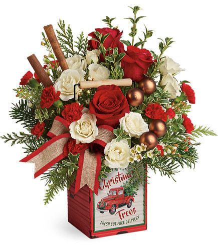 Quaint Christmas Bouquet hand delivered from Enchanted Florist. Capture the quaint charm of a country Christmas with this vintage-inspired metal cube, arranged with lush holiday roses, fresh winter greens and festive decorations! SKU T19X605