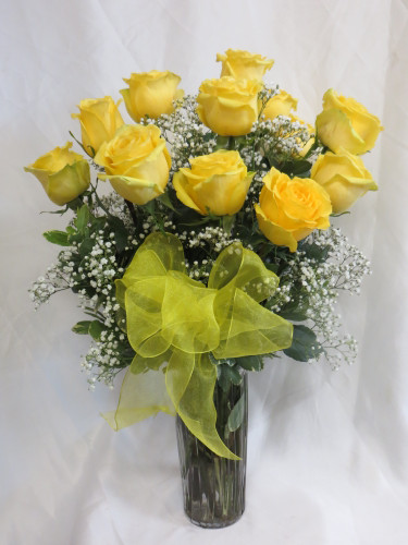 Sunny Dozen Yellow Roses by Enchanted Florist Pasadena TX - One dozen long stems yellow roses are arranged in a vase with baby's breath and ribbons as pictured. Don't make you special someone design her own flowers from a box! Our beautiful Ecuadorean roses are hand designed by expert floral artisans. RM372