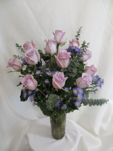 Twilight Dozen Purple Roses by Enchanted Florist Pasadena TX - One dozen long stems purple roses are arranged in a vase. Don't make you special someone design her own flowers from a box! Our beautiful Ecuadorean roses are hand designed by expert floral artisans. RM374