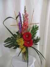 Perfectly Pincushion Protea Exotic Flower Arrangement by Enchanted Florist. This unique bouquet of tropical flowers includes red gerbera daisies, purple liatris, orange snapdragons and pincushion protea in a tall clear vase. Them the bouquet is accented with folded leaves and a bamboo trellis for a unique look. SKU RM169