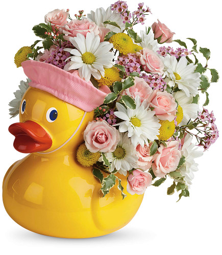 Baby Girls First Rubber Ducky Flower Bouquet by Enchanted Florist Pasadena TX.  This rubber ducky flower bouquet is professionally designed by our experts with white daisy spray chrysanthemums, pink spray roses, and yellow button spray chrysanthemums and accented with pink wax flower and various greenery. SKU RM 301