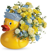 Baby Boys First Rubber Ducky Flower Bouquet by Enchanted Florist Pasadena TX. This rubber ducky flower bouquet is professionally designed by our experts with yellow daisy spray chrysanthemums, yellow spray roses, and white button spray chrysanthemums and blue delphinium and accented with various greenery. SKU RM 302