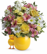 Sweet Peep in Pink New Baby Chick Flower Bouquet from Enchanted Florist. This cheerful new baby bouquet includes lush yellow roses, light pink alstroemeria, miniature light yellow carnations, white stock, white daisy mums, and various greenery. It's hand delivered by our real florist professionals in this happy chick vase.  SKU RM321