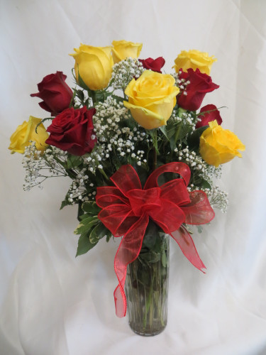 Dozen Red and Yellow Roses with Baby's Breath by Enchanted Florist - One dozen long stems red and yellow roses are arranged in a vase with baby's breath and ribbons as pictured.  Galena Park TX rose delivery. RM376