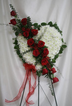 Bleeding Heart Funeral Flowers with Red Roses from Enchanted Florist.  Our standing spray arrangement - in the shape of a heart - is created from fresh white mums and red roses and is accented with eucalyptus. SKU RM574