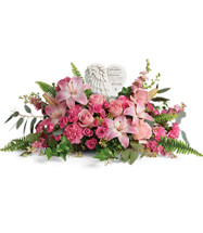 Heartfelt Farewell Bouquet Flowers in Pink from Enchanted Florist.  This beautifully heartfelt bouquet includes a variety of pink flowers including pink roses, pink spray roses, pink stargazer lilies, pink carnations, pink larkspur, eucalyptus, and other various greeneries. Delivered with a Heaven's Heart Keepsake.  SKU RM576