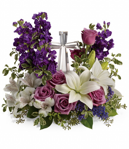 """Majestic Purple Large Crystal Cross from Enchanted Florist. This funeral bouquet of flowers includes lavender roses, white oriental lilies, white alstroemeria, purple stock and purple seafoam statice and is then arranged with fresh greeneries. It includes the large crystal cross keepsake. Cross is approximately 11""""H x 6""""W x 2""""D. Sympathy flower arrangement is approximately 15"""" W x 17"""" H SKU RM577"""