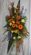 """Yellow Rose Autumn Funeral Spray of Flowers from Enchanted Florist. Our autumn sympathy arrangement of flowers includes orange gerbera daisies, birds of paradise, orange spray roses, yellow spiders, blue delphinium, orange snapdragons, and are accented with various greenery and arrives on a funeral easel. Approximately 70""""H x 30""""W  SKU RM515"""