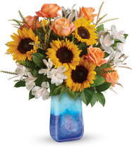 "Sunflower Beauty Bouquet in Blue Vase from Enchanted Florist. Our fun fall flower arrangement includes orange roses, white alstroemeria, and medium yellow sunflowers are professionally designed with grevillea and lemon leaf. They come hand delivered, (never in a box) in a Blue Lapis Gemstone Art Glass vase. Approximately 19"" W x 20"" H SKU RM224"
