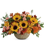 """Amazing Autumn Sunbeams Sunflower Bouquet from Enchanted Florist. Your sunny fall centerpiece features yellow alstroemeria, peach miniature carnations, medium yellow sunflowers, bronze cushions, spiral eucalyptus, huckleberry, and brown fall oak leaves. Delivered in an Artisanal Autumn Bowl. Approximately 19"""" W x 13"""" H SKU RM225"""
