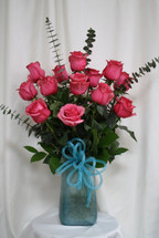 "Turquoise Vase with Hot Pink Rose Bouquet from Enchanted Florist. This beautiful bouquet of roses includes 15 premium pink roses arranged along side spiral eucalyptus, adorned with a turquoise bow and arrives in our beautiful exclusive turquoise art vase. Approximately 24""H x 16""W SKU RM357"