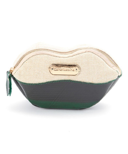 Green Lip Cosmetic Bag Product Description: A lip shape brings cheeky flair to this cosmetic bag, secured with a zip closure. •	8'' W x 4.5'' H x 2.5'' D •	Zip closure •	Outer: reclaimed upcycled layflat irrigation hoses •	Lining: nylon •	Waterproof