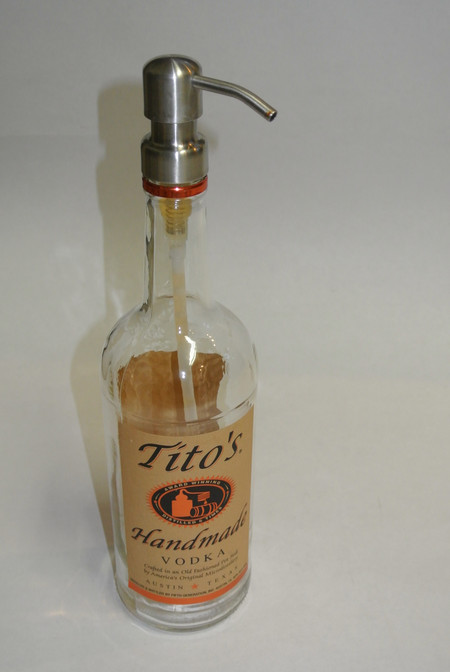 Recycled Glass Bottle Wash your hands using an upcycled Tito's Handmade Vodka Bottle. This Bottle and Pump can be used for lotion too! We only use stainless steel heavy duty and Sturdy pumps on our recycled bottles, which will pump even the Thickest Liquids. Our sustainable eco friendly bottles make a great conversation pieces. Did you know by purchasing our products you are helping to keep glass out of landfills in California. This year give a unique gift that helps our carbon footprint. Reclaimed Bottles from Landfill Dzine are wrapped in our recycled bags