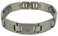 "Stainless Steel CZ Bracelet    Highly polished stainless steel bracelet    with a cubic zirconia accent stone.    Size. 8.5"" long"