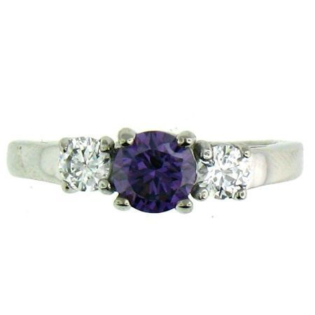 Stainless Steel Purple Cubic Zirconia Ring  Available Sizes: 5 - 10   Stainless steel cubic zirconia ring.   Center stone: February Birthstone  -  Light Amethyst Purple CZ Approx. Width: 6mm  Approx. Weight: 2.80 grams