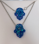 Stainless Steel Chain With Blue Resin Hamsa Hand And matching Bracelet Chain is 20 inches Bracelet is 7.5 inches