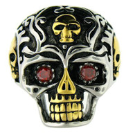 Large stainless steel skull ring with red CZ eyes!  MUST SEE!!! This ring has intricate detailing with gold plated accents!!  Available Sizes: 8 - 16   Approx. Dimensions: 30mm x 30mm!!   Approx. Weight: 36 grams