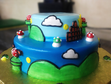 From Nintendo Land, this is a creation of Super Mario World.  Everything has been hand designed and sculpted with meringue icing and is all edible!