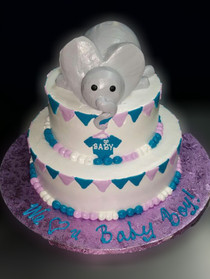 "Approximate Servings 30-35. Sizes 8"" & 10"". Two tiered elephant themed baby shower cake. Elephant is edible."