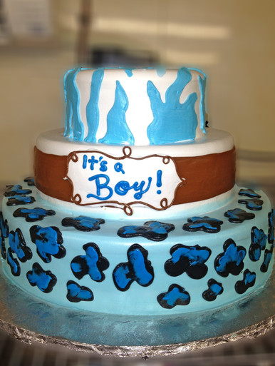 "Approximate Servings 80. Sizes: 7"", 10"" & 14"". Three tiered animal print baby shower themed cake."