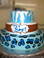 """Approximate Servings 80. Sizes: 7"""", 10"""" & 14"""". Three tiered animal print baby shower themed cake."""