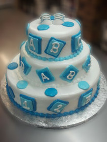 "Approximate Servings 80. Sizes: 7"", 10"" & 14"". Inspired by a babys first steps, letters and numbers this cake is perfect for your event."
