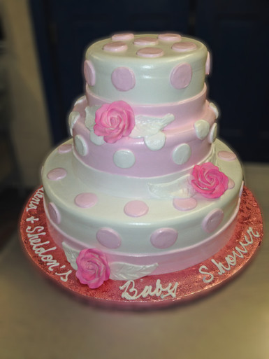 "Approximate Servings 80. Sizes: 7"", 10"" & 14"". Three tiered floral and polka dot design."